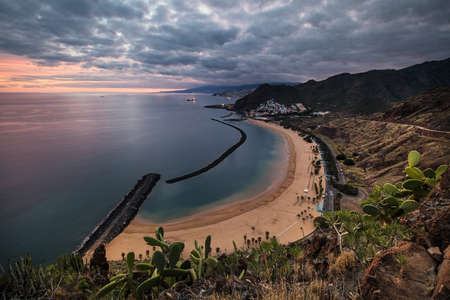 Coastline view of Playa de Las Teresitas beach, San Andres town and the capital city Santa Cruz de Tenerife in the background. The sand for this beach has been shipped from the Sahara desert