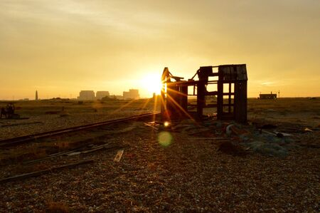 A Damaged Outhouse By Rail Tracks Gets Hit By The Setting Suns Rays