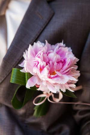lapel: pink peony on a gray jacket lapel groom