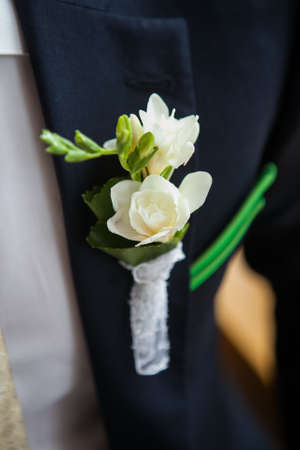 lapel: white freesia pinned to the lapel of the groom