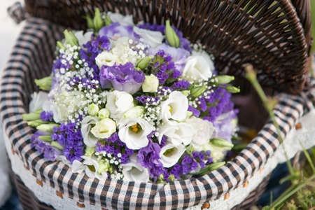 bouquet of eustomy lies in a basket