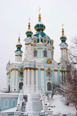 Famous touristic places in Kyiv - view to St Andrews Church in capital of Ukraine at winter