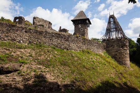 Ruins of Castle Nevytske near of Transcarpathian region center, Uzhgorod photo. Nevitsky Castle ruins built in 13th century. Ukraine. Stock Photo