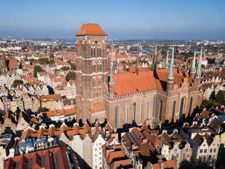 Aerial view from drone on St. Mary Cathedral and City Hall spire clock tower in Gdansk, Poland