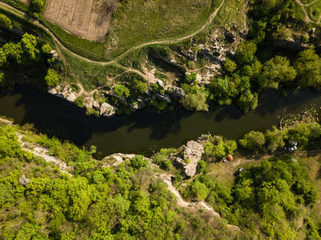 Aerial amazing view to Buky Canyon on sunny day. Buki Canyon on the Hirskyi Tikich river, Cherkassy region, Ukraine