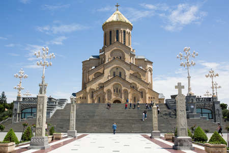 Tbilisi, Georgia - June 20 2018: Main view with steps to Tbilisi Holy Trinity Cathedral commonly known as Sameba main Georgian Orthodox Christian cathedral located in Tbilisi, capital of Georgia