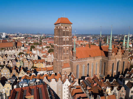 Aerial view from drone on St. Mary Cathedral and City Hall spire clock tower in Gdansk, Poland Reklamní fotografie