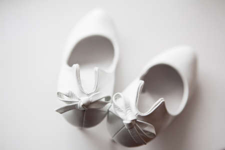 Gorgeous wedding shoes in heels on a white background