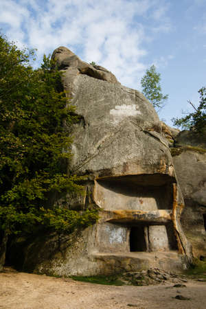 Dovbush Rocks in Bubnyshche. Legendary ancient cave monastery in fantastic boulders amidst beautiful scenic forests in Carpathian Mountains, Ukraine
