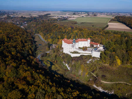 Medieval castle Pieskowa Skala near Krakow in Poland. Aerial spectacular view in beautiful autumn Editorial