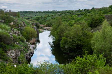 Aerial amazing view to Buky Canyon on sunny day. Buki Canyon on the Hirskyi Tikich river, Cherkassy region, Ukraine