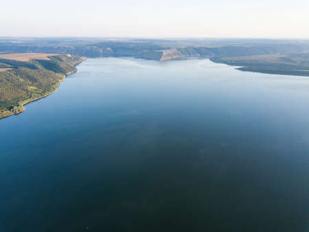 Aerial scenic panorama view from rock monastery Bakota to the reservoir on the Dniester river, Ukraine