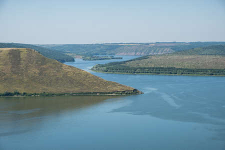 Aerial view to Bakota bay, Ukraine, scenic view to Dniester river, stones above the lake blue water, sunny day