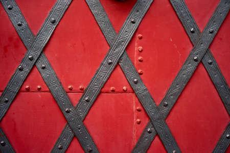 Closeup on vintage, heavily red metal closed door
