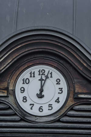 White dial. Arrows indicate the beginning of the first.