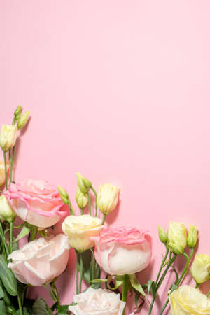 Floral background. Eustoma and pink roses on a pink background. Holiday concept and copy space.