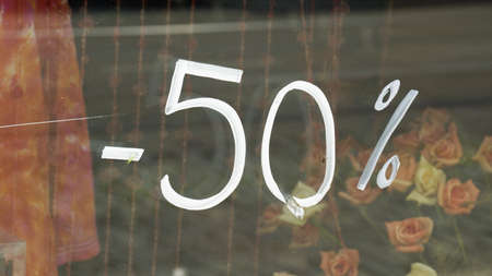 sell out: 50% discount is written on a window Stock Photo