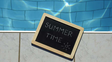 summer time: Summer time written on a chalboard  at a pool