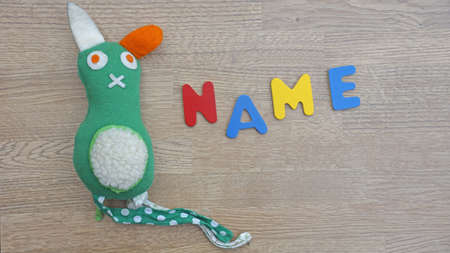 Choosing baby name written with wooden letters Фото со стока