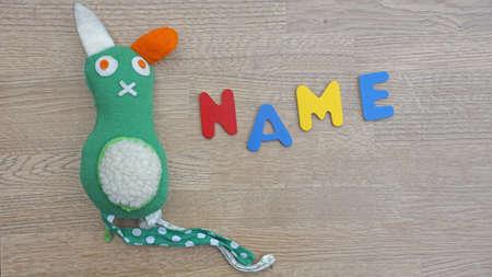 Choosing baby name written with wooden letters Reklamní fotografie