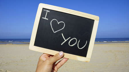 I love you written on a chalkboard on the beach Stock Photo - 22143526