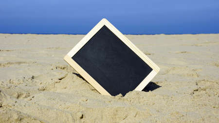 blanco: A blanco chalkboard on the beach Stock Photo