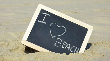 I love beach written on a chalkboard on the beach photo