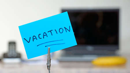 absent: Vacation written on a memo at the office