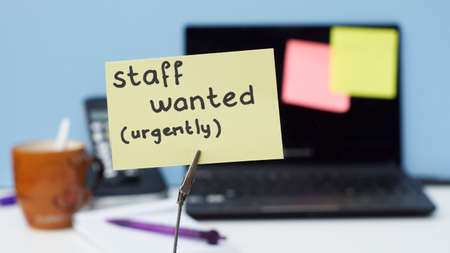 Staff wanted urgently written on a memo in a office photo