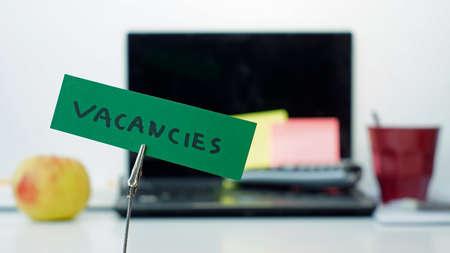 vacancies: Vacancies written on a memo at the office Stock Photo