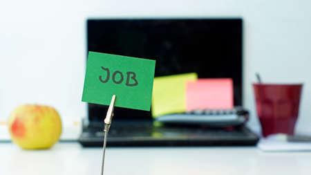 Job written on a memo at the office Standard-Bild