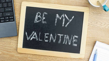 Be my valentine word on a blackboard photo