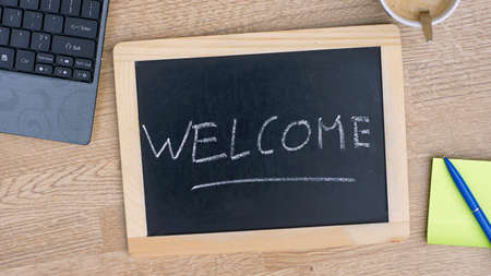 Welcome written on a chalkboarde at the office photo