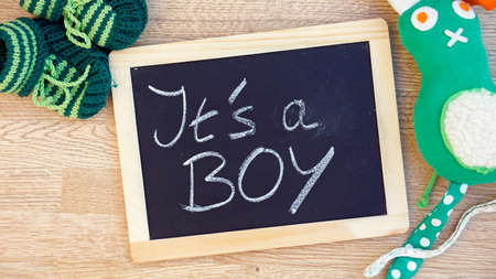 Its a boy written on a chalkboard in the babyroom Stock Photo