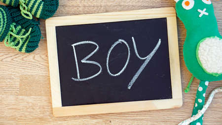 Boy written on a chalboard at the baby room  photo
