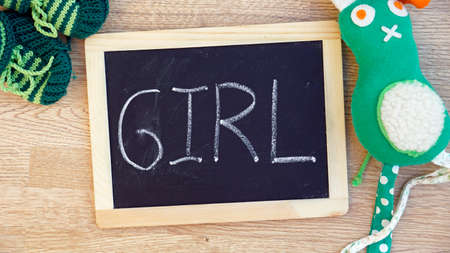 babyroom: Girl written on a chalkboard in the babyroom