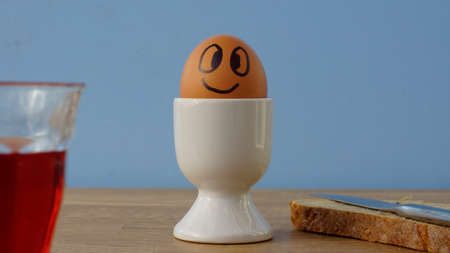 Smiling funny egg at the breakfast photo