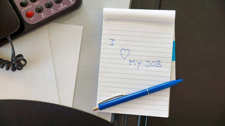 I love my job written on a blocknote at the office photo