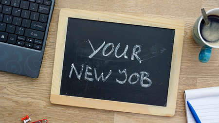 You new job written on a chalkboard at the office