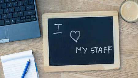garden staff: I love my staff written on a chalkboard at the office Stock Photo