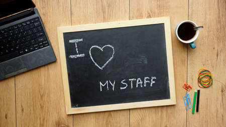 holidays vacancy: I love my staff written on a chalkboard at the office Stock Photo
