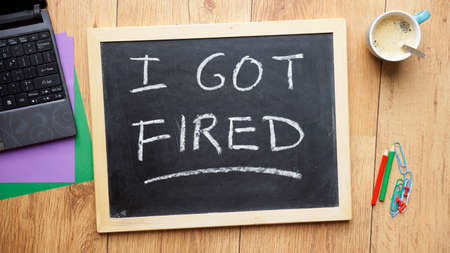 dismiss: I god fired written on a chalkboard at the office