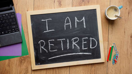 I am retired written on a chalkboard at the office photo