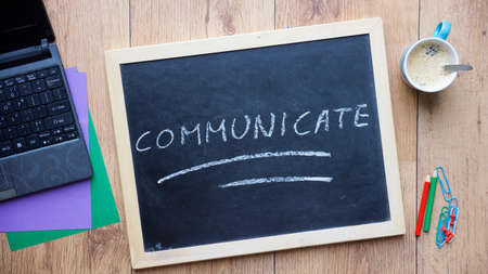 nonverbal communication: Communicate written on a chalkboard at the office
