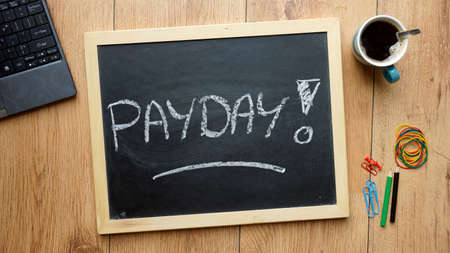 Payday written on a chalkboard at the office