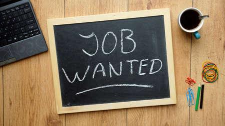 Job wanted written on a chalkboard at the office Фото со стока