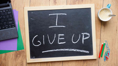 I give up written on a chalkboard at the office