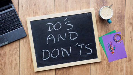 Dou0027s And Donu0027ts Written On A Chalkboard At The Office Stock Photo   29626837