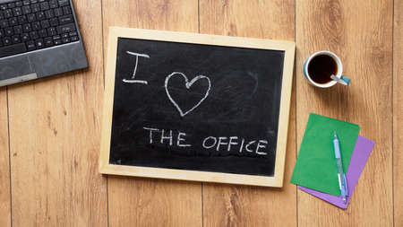 i nobody: I love the office written on a desk at the office Stock Photo