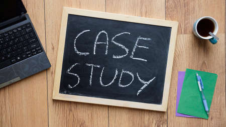 case study: Case study written on a chalkboard at the office